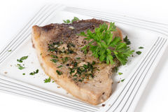 Garnished swordfish steak Royalty Free Stock Photo