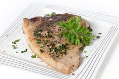 Garnished swordfish steak Royalty Free Stock Photo