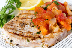 Garnished swordfish steak Stock Image