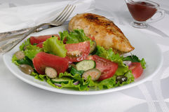 Garnished with vegetables with chicken schnitzel Stock Photo