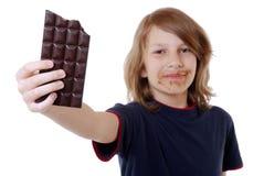 Garçon avec du chocolat Images stock