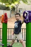 Garçon d'enfant dans le terrain de jeu Images stock