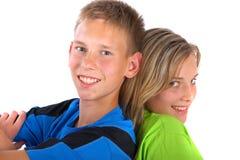 Garçon et fille dos à dos Photos stock