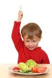 Garçon et légumes Image libre de droits