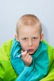 Garçon malade Photographie stock libre de droits