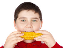 Garçon mangeant du maïs Image libre de droits