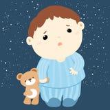 Garçon mignon et sa poupée sans sommeil Photo libre de droits