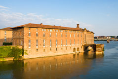 Garonne river and historic building. Historic building in the centrs of Toulouse near the garonne river.Hotel-Dieu Saint Jacques, former 16th and 17th century Royalty Free Stock Photography