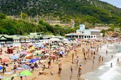 Garraf Beach in Sitges, Spain. SITGES, SPAIN - JULY 9, 2017: People enjoying, relaxing, sunbathing or bathing at the Garraf Beach in Sitges, a popular beach in Royalty Free Stock Photo