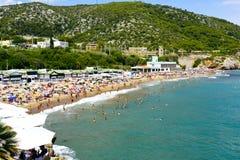 Garraf Beach in Sitges, Spain. SITGES, SPAIN - JULY 9, 2017: People enjoying, relaxing, sunbathing or bathing at the Garraf Beach in Sitges, a popular beach in Royalty Free Stock Images