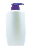 Garrafa branca limpa plástica com a bomba azul do distribuidor no fundo branco Fotos de Stock Royalty Free