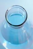 Garrafa com azul líquido Imagens de Stock Royalty Free