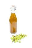 Garrafa de azeite com azeitonas Imagem de Stock Royalty Free