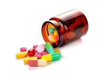 Garrafa de comprimido que derrama comprimidos Imagens de Stock