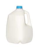 Garrafa de leite do galão com o tampão azul isolado no branco fotos de stock royalty free