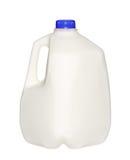 Garrafa de leite do galão com o tampão azul isolado no branco imagens de stock royalty free