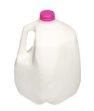 Garrafa de leite do galão com o tampão cor-de-rosa isolado no branco fotos de stock royalty free