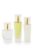 Garrafa de perfume de três vidros no fundo branco Fotografia de Stock Royalty Free