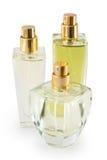 Garrafa de perfume de três vidros no fundo branco Foto de Stock