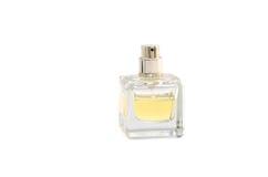 Garrafa de perfume do ` s das mulheres em um fundo branco Fotografia de Stock
