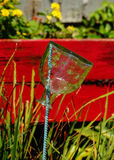 Garrafa de vidro do vintage que descansa na haste Foto de Stock Royalty Free