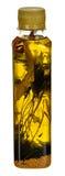 Garrafa do óleo vegetal com o erval para cozinhar isolado no fundo branco com trajeto de grampeamento Fotos de Stock