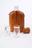 Garrafa do quadril e dois vidros Imagens de Stock Royalty Free