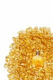 Garrafa do vintage e pedras ambarinas amarelas Imagem de Stock Royalty Free