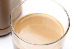 Garrafa e vidro de leite de chocolate Imagens de Stock