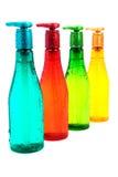 Garrafa plástica completa da cor Fotografia de Stock