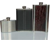 Garrafa três lisa para o álcool isolado no branco Fotos de Stock Royalty Free