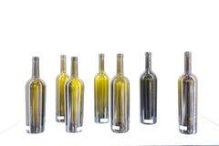 Garrafa vazia do vinho em um fundo branco Fotos de Stock Royalty Free