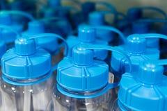 Garrafas azuis da bebida do esporte com tampão de segurança Fotografia de Stock Royalty Free