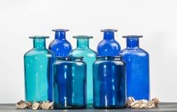 Garrafas azuis e verdes Fotos de Stock Royalty Free