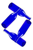 Garrafas azuis isoladas no fundo branco Imagens de Stock