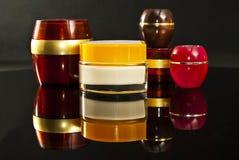 Garrafas coloridos do creme. Imagens de Stock Royalty Free