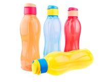 Garrafas de água coloridas Imagens de Stock
