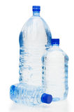 Garrafas de água isoladas no fundo branco Imagens de Stock Royalty Free