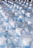 Garrafas de água na película de plástico Imagens de Stock Royalty Free