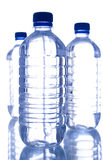 Garrafas de água plásticas Fotografia de Stock Royalty Free