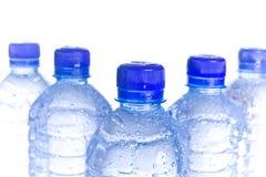 Garrafas de água plásticas Fotografia de Stock