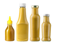 Garrafas de uma mostarda do amarelo Fotos de Stock