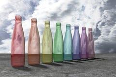 Garrafas de vidro coloridas Fotos de Stock Royalty Free