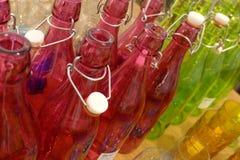 Garrafas de vidro coloridas Fotos de Stock