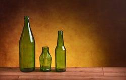 Garrafas de vidro na tabela Foto de Stock Royalty Free