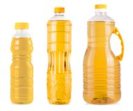Garrafas do óleo de girassol isoladas no fundo branco Fotos de Stock