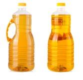 Garrafas grandes do óleo de girassol isoladas no fundo branco Imagens de Stock