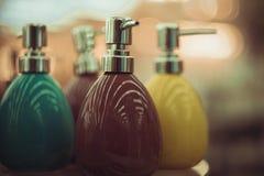 Garrafas para o sabão na loja Fotografia de Stock Royalty Free