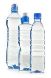 Garrafas plásticas da água mineral no branco Fotografia de Stock Royalty Free
