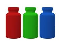 Garrafas verdes e azuis vermelhas da vitamina Foto de Stock Royalty Free